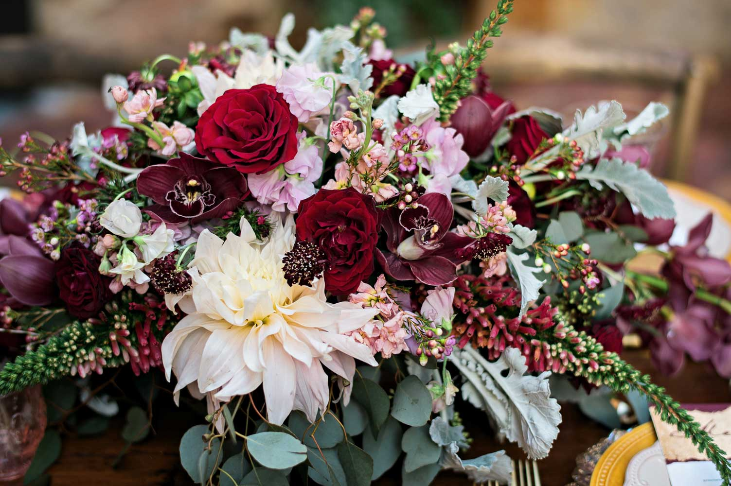 multicolored pink red and magenta flower arrangement