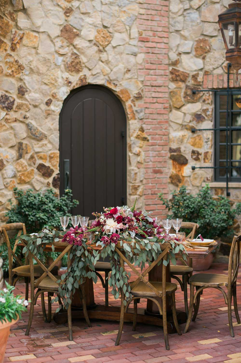 outdoor brick patio table with magenta flowers