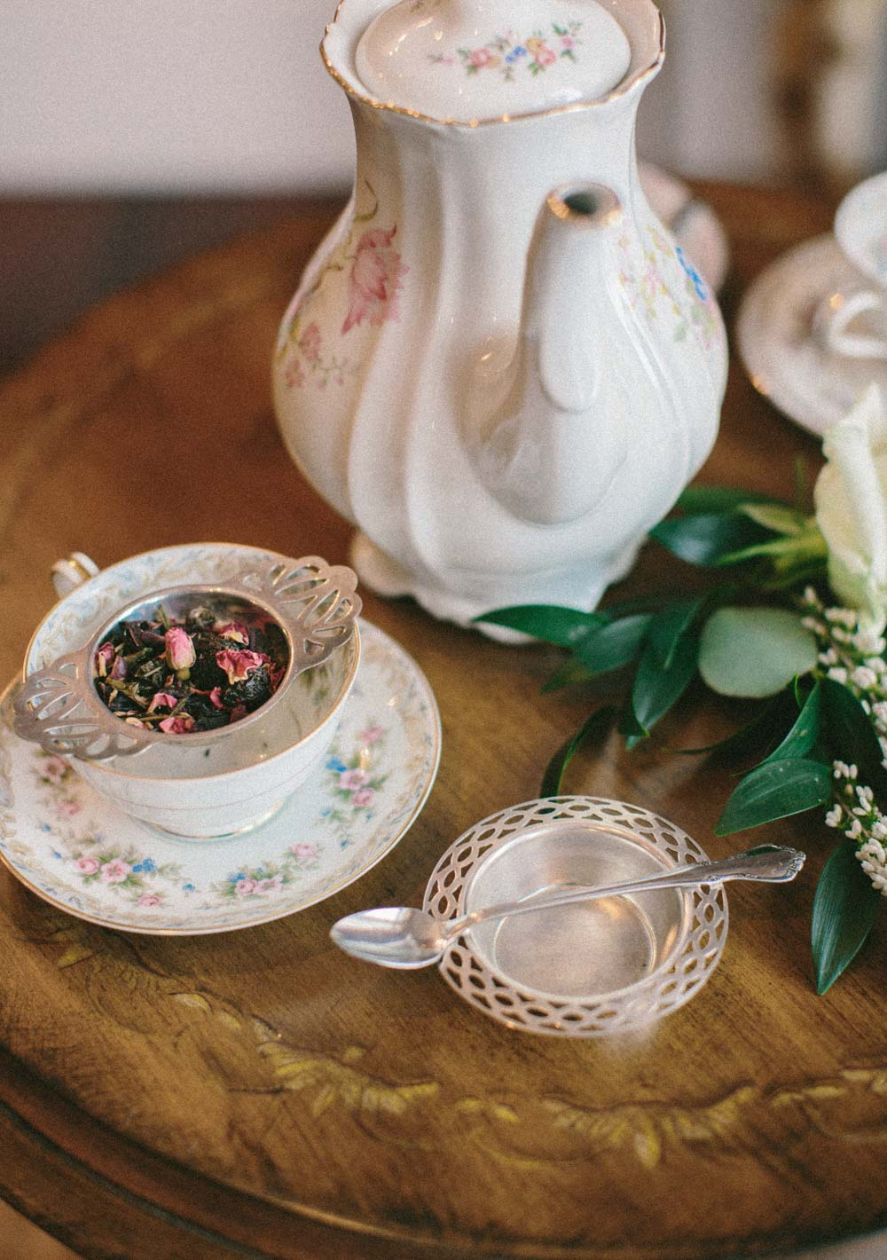 rose tea in floral printed china tea set