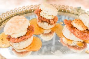 mirrored platter with mini chicken and biscuit hor d'oeuvres