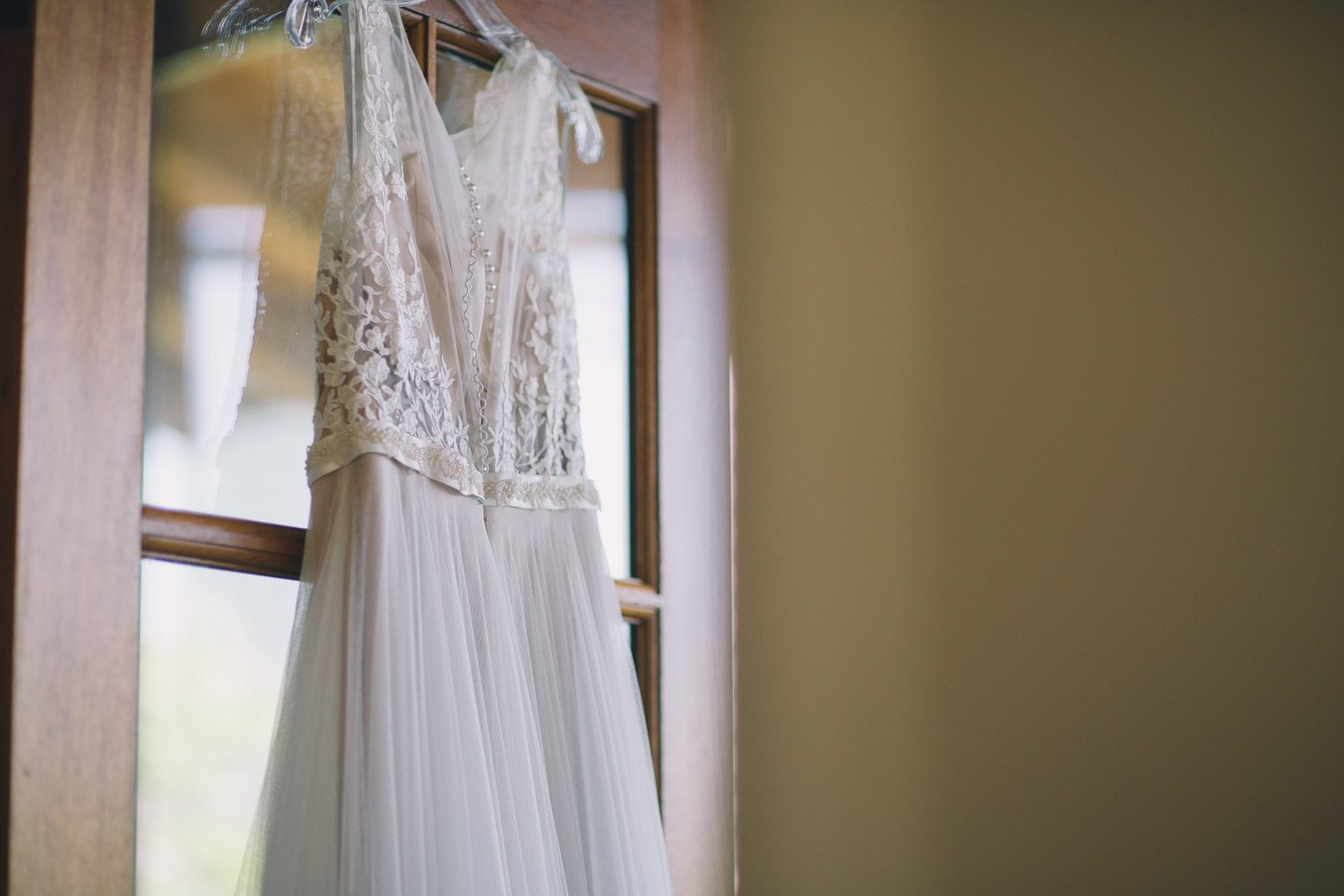 white-lace-wedding-dress-hanging