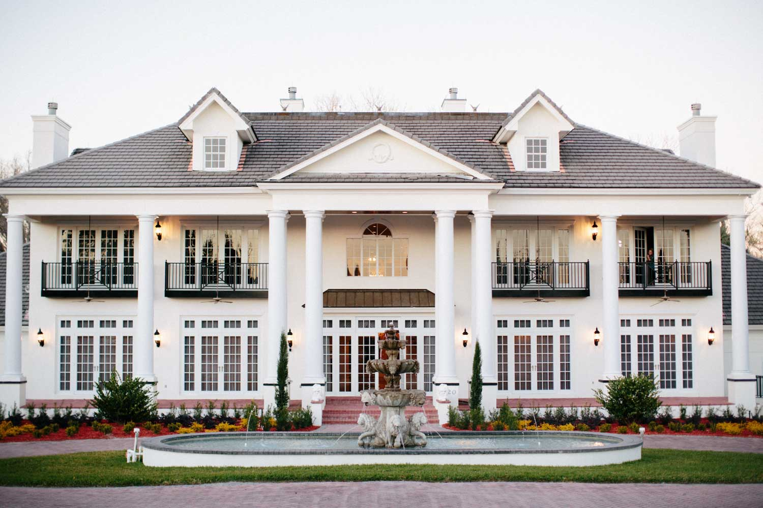 white mansion with french doors and columns