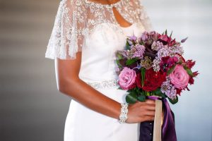 purple pink red gold bridal bouquet beaded lace dress details bridal accessories