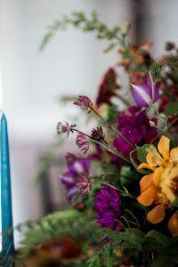 magenta orange multicolored wedding flower arrangement