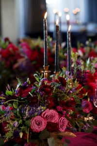 colorful centerpiece red purple pink flowers candles