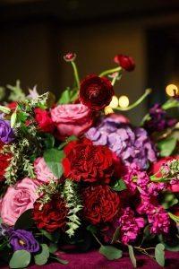 red purple pink floral arrangements wedding