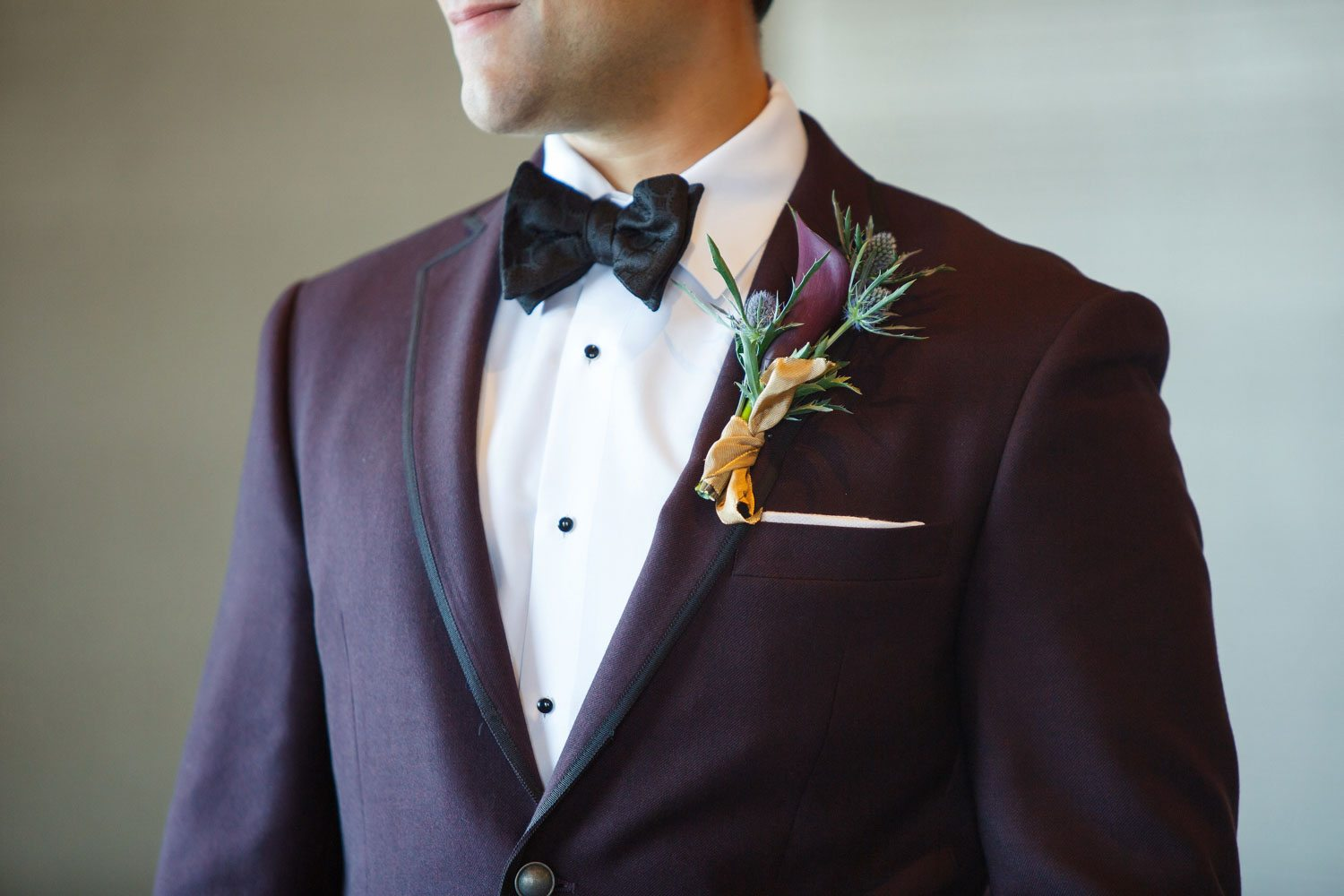 groom purple plum boutonniere