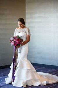 beaded lace detail wedding dress colorful wedding bridal bouquet pink purple red gold