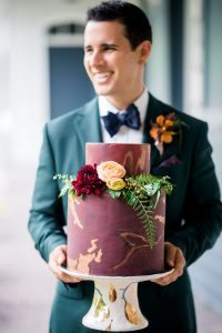 magenta gold leaf detail floral wedding cake