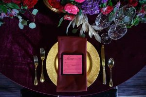 colorful wedding place settings pink and black menu cards gold red pink purple maroon flowers