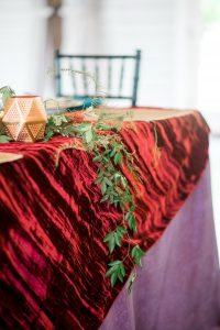 wedding guest table decor red gold purple gold accents wedding decor