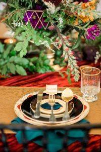 colorful wedding reception place setting emerald gold fuschia orange yellow