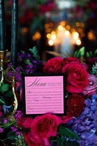 black and pink velvet menu card purple pink red floral arrangements