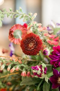 bold wedding flowers floral arrangements red pink purple