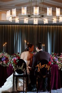 bold weddings bride and groom purple