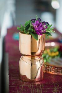 brass cup with purple flower wedding decor