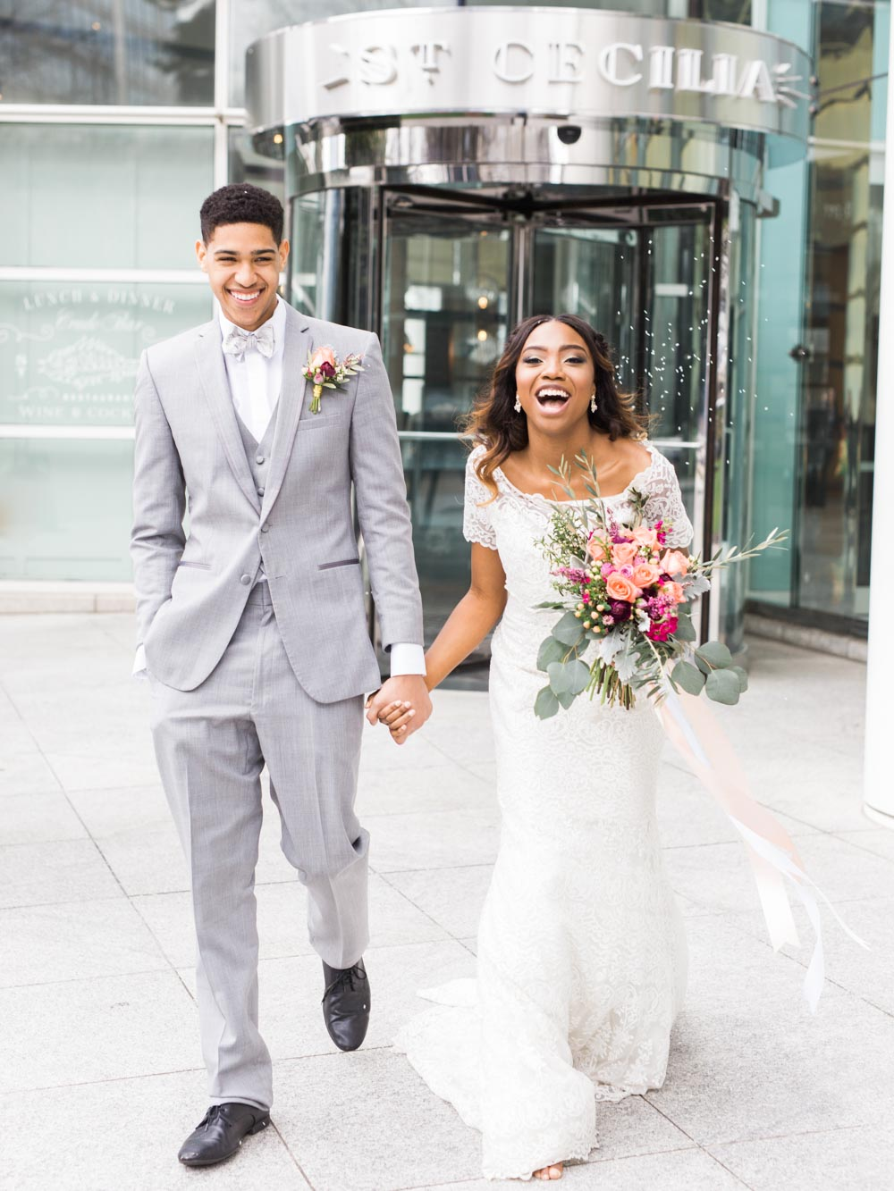 gray tuxedo lace off the shoulder wedding dress pink bridal bouquet boutonniere