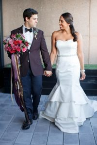 bride groom colorful weddings wedding dress strapless maroon tuxedo red pink purple gold bridal bouquet