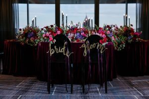 bold wedding bride groom signs gold pink purple red centerpieces