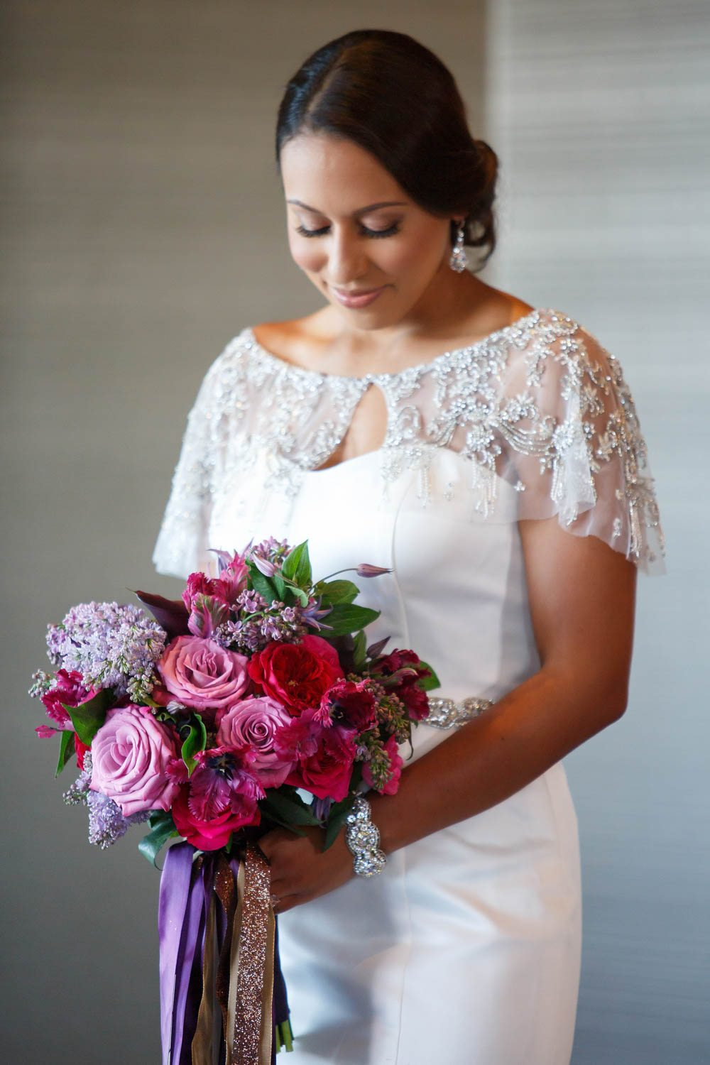 bride lace dress bridal updo colorful wedding bridal bouquet