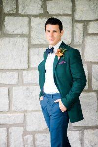 emerald tuxedo jacket orange boutonniere colorful groom fashion
