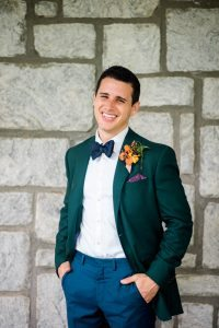 colorful wedding emerald tuxedo jacket orange boutonniere groom fashion