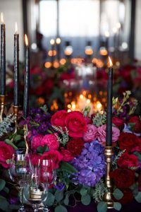 purple pink red gold flowers candles centerpieces