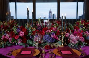 colorful weddings place settings gold red purple pink candles flowers
