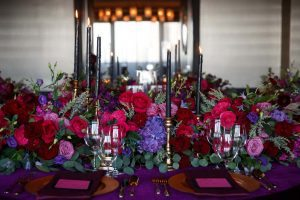 purple pink red gold flowers candles place setting