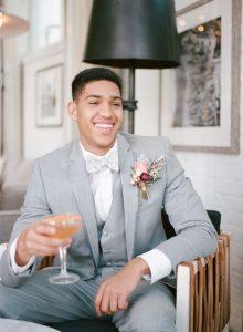grey tuxedo groom peach pink magenta boutonniere orange wedding cocktail