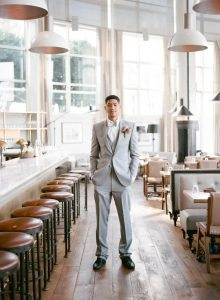grey tuxedo groom peach pink magenta boutonniere black dress shoes