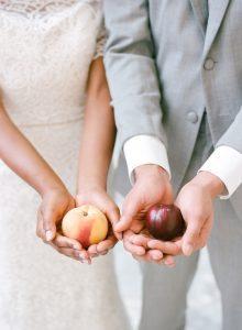 couple holding peaches