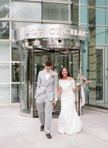 bride groom grey tuxedo lace off the shoulder wedding dress