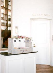 wedding reception gelato dessert bar chalkboard signs magenta red floral decoration