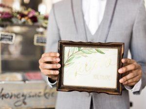 wooden framed gelato bar sign gold caligraphy