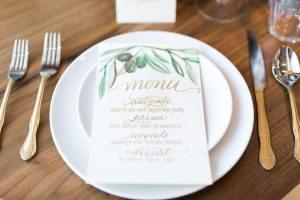 wedding menu card green floral details golden caligraphy