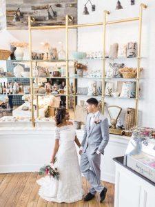 modern restaurant wedding reception venue of the shoulder lace wedding dress grey tuxedo purple pink magenta bouquet boutonniere