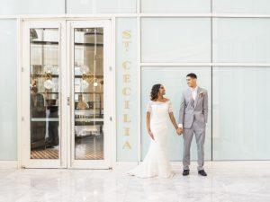 grey tuxedo black dress shoes white lace off the shoulder wedding dress