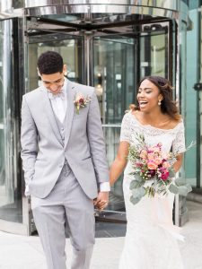 off the shoulder wedding dress grey tuxedo peach magenta purple bouquet boutonniere