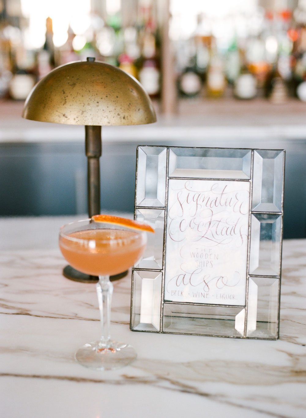 calligraphy wedding cocktail sign glass frame orange cocktail