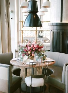 pink peach magenta floral centerpiece wedding reception table restaurant venue