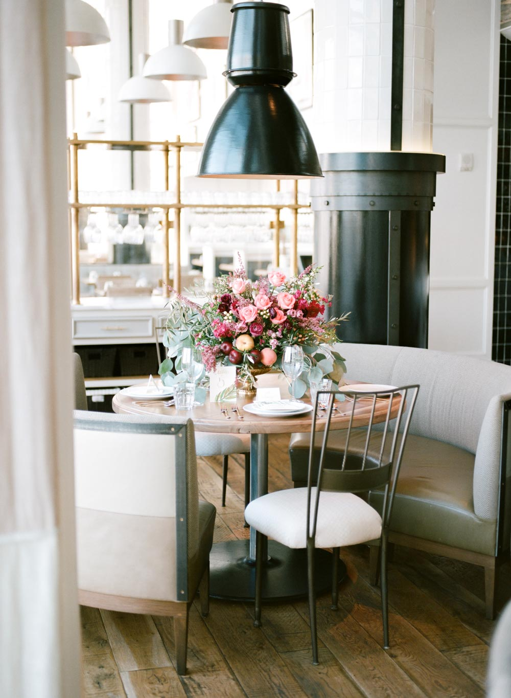 simple pink peach magenta floral centerpiece wedding reception table restaurant venue