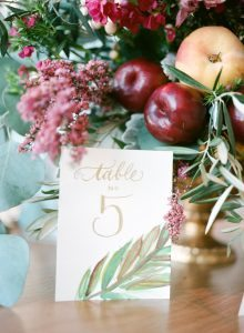 simple golden calligraphy leaf detail escort card