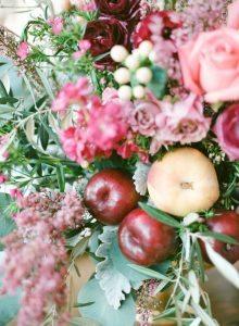 peach apple pink floral arrangement wedding reception