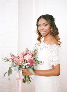 off the shoulder lace wedding dress pink peach magenta bridal bouquet half up half down bridal hair style