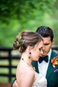 bridal updo hairstyle bold bridal jewelry purple emerald green silver gold flowers