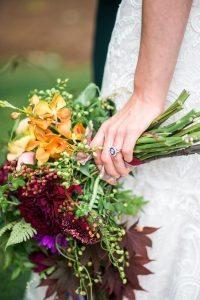 multicolored bridal bouquet maroon yellow orange magenta