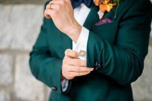 groom fashion emerald tuxedo jacket orange yellow purple boutonniere