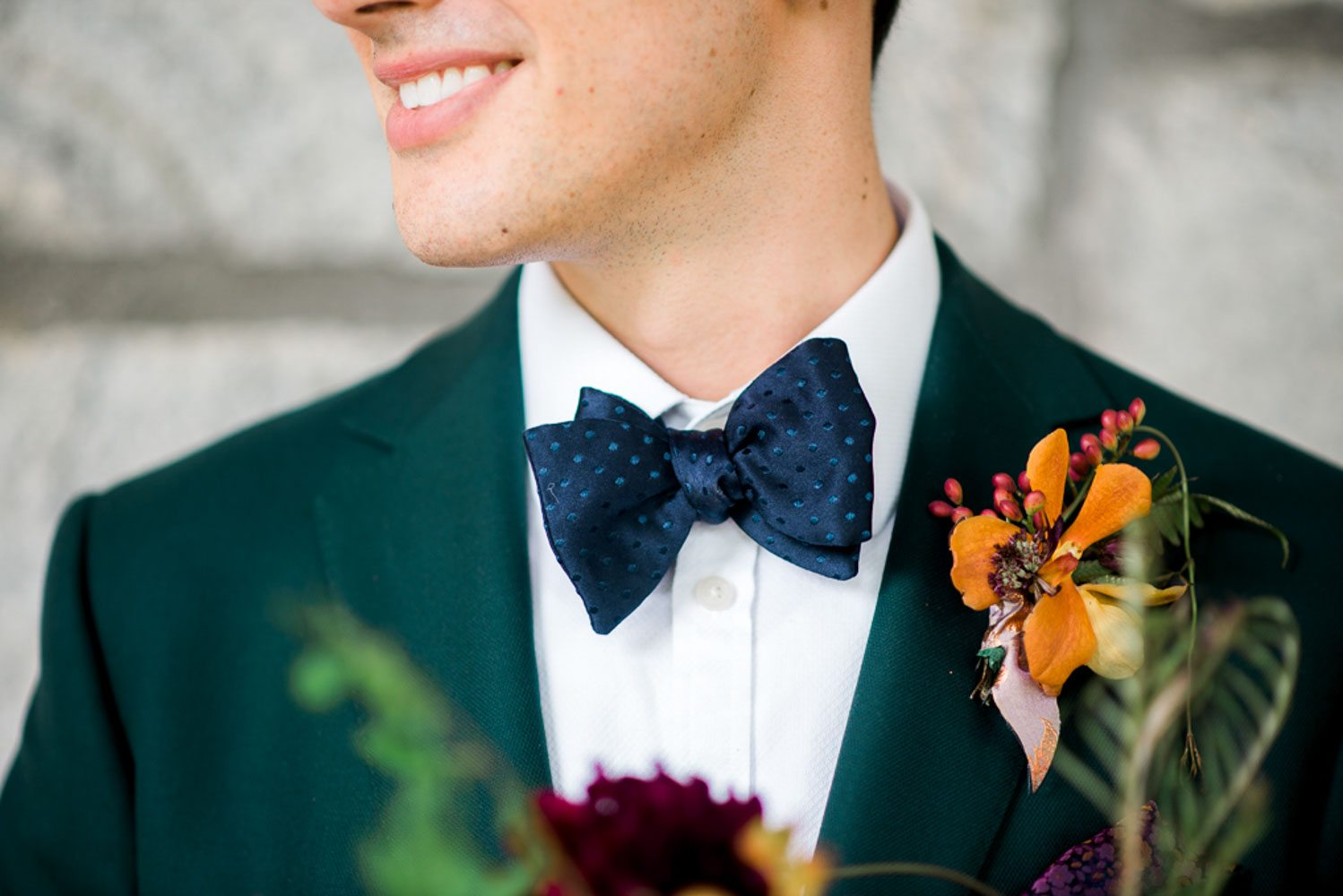 groom fashion emerald tuxedo jacket orange yellow purple boutonniere