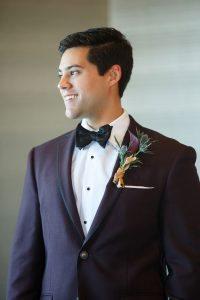 groom purple plum boutonniere